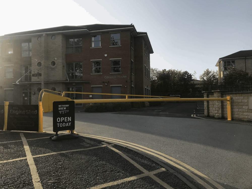 The entrance gate to York Road Estate, Wetherby with a yellow barrier that is closed